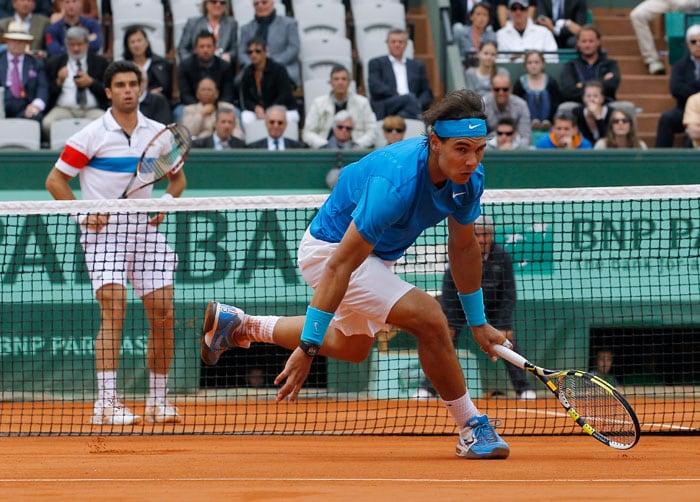 Rafael Nadal registered a far from comfortable straight set win over countryman Pablo Andujar to reach the Third Round. (AFP Photo)