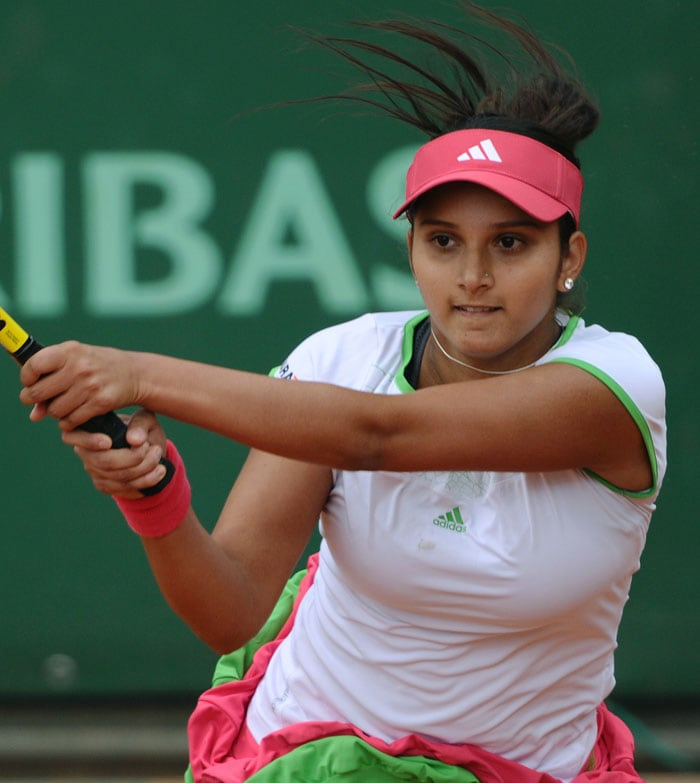 Sania Mirza's stay at the French Open was cut short by twelfth seed Agnieszka Radwanska as she lost 6-2, 6-4. (AFP Photo)