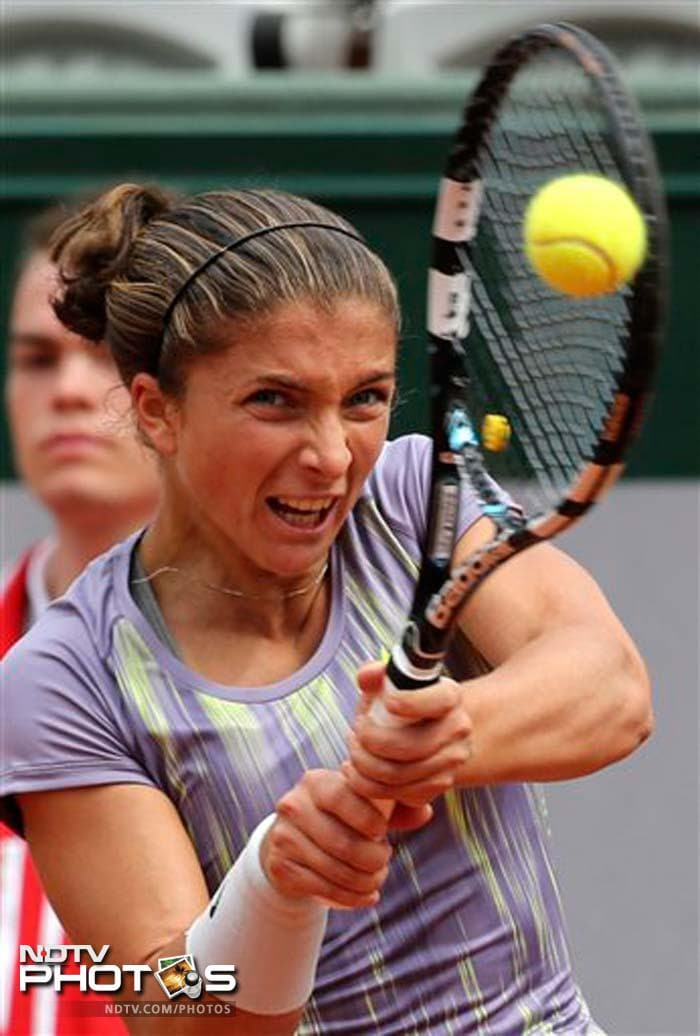 2012 runner-up Sara Errani was the first to enter the second round of French Open after she beat Arantxa Rus of the Netherlands 6-1, 6-2.