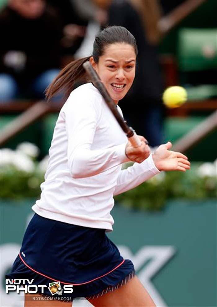 2008 champion Ana Ivanovic of Serbia overcame an inconsistent performance in a chilly start at the French Open and held on to beat 108th-ranked Petra Martic of Croatia 6-1, 3-6, 6-3 Sunday.