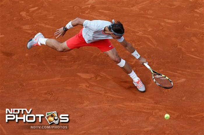 Rafael Nadal cruised into the semi-finals with a routine win over Stanislas Wawrinka. The win brought the Spaniard's match record at Roland Garros to a remarkable 57-1 as he seeks to become the first player in history to win the same Grand Slam title eight times.
