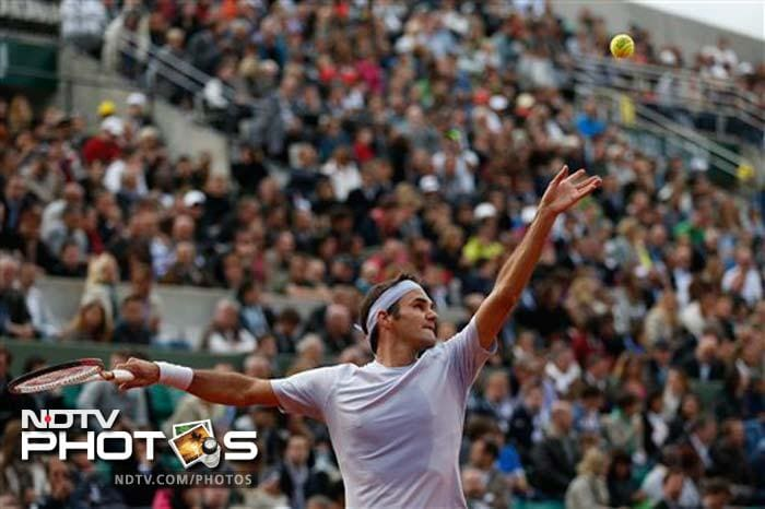Roger Federer, the 2009 champion, raced into the third round with a thrashing victory over India's Somdev Devvarman. Federer, who bagged his 56th win on the red Roland Garros, next faces Julien Benneteau of France.