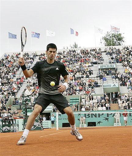 Serbia's Novak Djokovic returns the ball to Latvia's Ernests Gulbis during their quarterfinal match of the French Open on June 3, 2008 at the Roland Garros stadium in Paris.