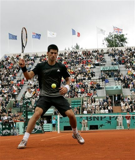 Spain's Nicolas Almagro returns the ball to Spain's Rafael Nadal during their quarterfinal match at the French Open in Paris June 3, 2008.