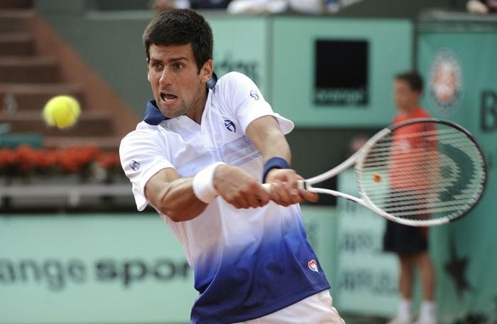 Serbia's Novak Djokovic plays a return against Austria's Jurgen Melzer. Melzer defeated Serbian third seed Novak Djokovic 3-6, 2-6, 6-2, 7-6 (7/3), 6-4. (AFP PHOTO)