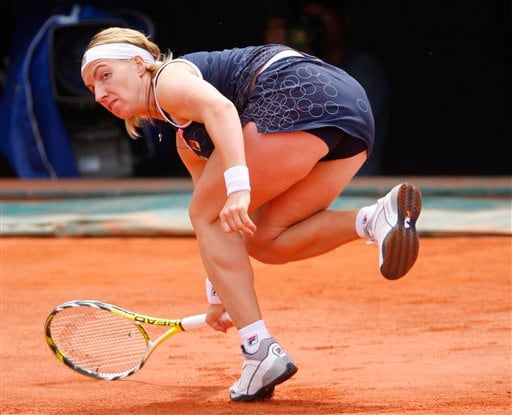 Russia's Svetlana Kuznetsova tries to return the ball to compatriot Dinara Safina during their semifinal match of the French Open tennis tournament on Thursday, June 5, 2008 at the Roland Garros stadium in Paris.