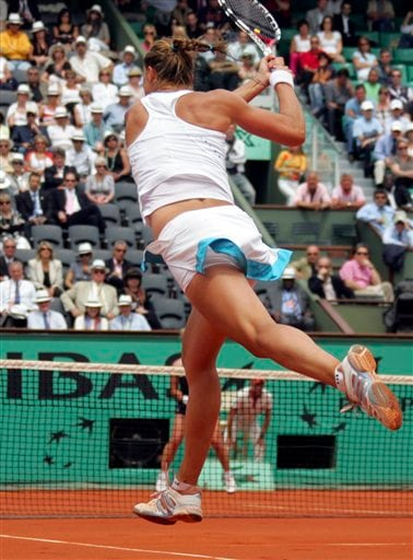 Russia's Dinara Safina returns the ball to Russia's Svetlana Kuznetsova during their semifinal match at the French Open tennis tournament in Paris on Thursday June 5, 2008.