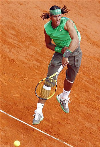 Spain's Rafael Nadal serves the ball to Serbia's Novak Djokovic during their semifinal match at the French Open in Paris on June 6, 2008.