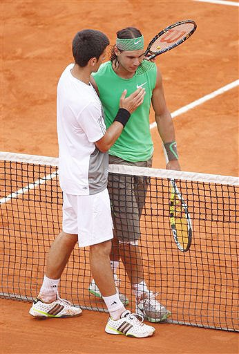Spain's Rafael Nadal receives a hand on the chest from Serbia's Novak Djokovic after their semifinal match at the French Open in Paris on June 6, 2008.