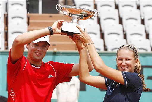 USA's Bob Bryan and Belarus Victoria Azarenka hold their trophy after defeating Slovenia's Katarina Srebotnik and Serbia's Nenad Zimonjic during their mixed doubles final match of the French Open on June 6, 2008 at the Roland Garros stadium in Paris.