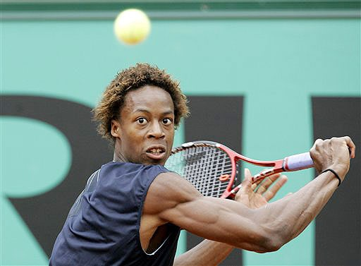 France's Gael Monfils returns the ball to Switzerland's Roger Federer during their semifinal match of the French Open on June 6, 2008 at the Roland Garros stadium in Paris.