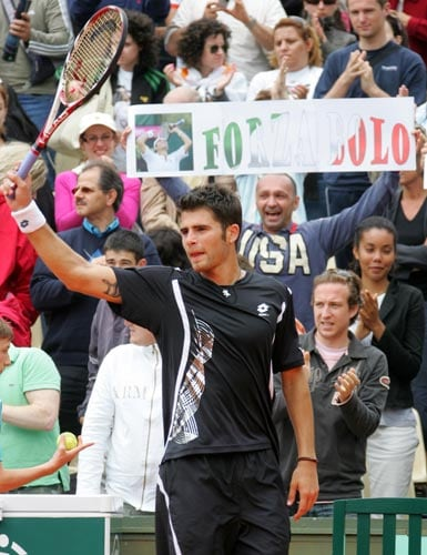 Italy's Simone Bolelli waves to the public after defeating Cyprus' Marcos Baghdatis during their first round match of the French Open tennis tournament on Monday May 26, 2008 at the Roland Garros stadium in Paris.