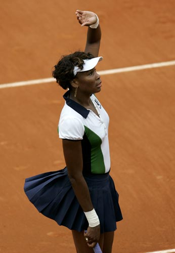 United States' Venus Williams waves to the public after defeating Israel's Tzipora Obziler during their first round match of the French Open tennis tournament on Monday May 26, 2008 at the Roland Garros stadium in Paris. Williams won 6-3, 4-6, 6-2.