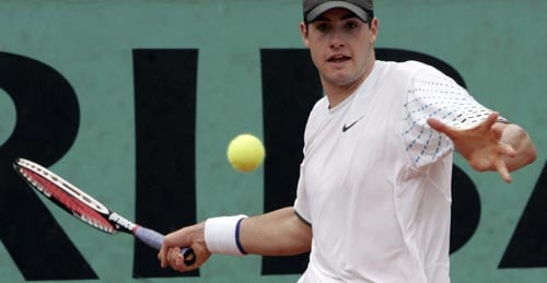 United States player John Isner returns the ball to Argentina's Juan Ignacio Chela during their first round match at the French Open tennis tournament in Paris on Monday May 26, 2008.