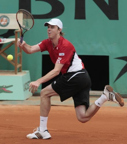 United States player Sam Querrey runs to return the ball to Switzerland's Roger Federer during their first round match at the French Open tennis tournament in Paris on Monday May 26, 2008.