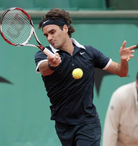 Switzerland's Roger Federer returns the ball to United States player Sam Querrey during their first round match at the French Open tennis tournament in Paris on Monday May 26, 2008.