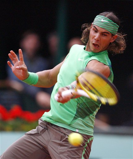 Spain's Rafael Nadal returns the ball to Brazil's Tomaz Bellucci during their first round match at the French Open tennis tournament in Paris on Tuesday, May 27, 2008.