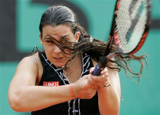 France's Marion Bartoli returns the ball to Australia's Casey Dellacqua during their first round match of the French Open tennis tournament on Tuesday, May 27, 2008 at the Roland Garros stadium in Paris.