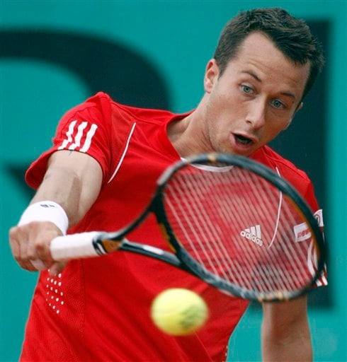 Germany's Philipp Kohlschreiber returns the ball to Switzerland's Stanislas Wawrinka during their first round match at the French Open tennis tournament in Paris on Tuesday, May 27, 2008.