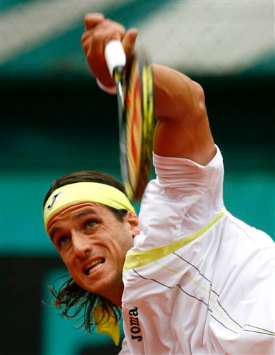 Spain's Feliciano Lopez serves to Argentina's Martin Vassalo Arguello during their first round match of the French Open tennis tournament on Tuesday, May 27, 2008 at the Roland Garros stadium in Paris.