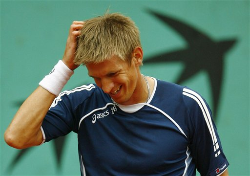Finland's Jarkko Nieminen scratches his head as he plays Spain's Marc Lopez during their first round match of the French Open tennis tournament on Tuesday, May 27, 2008 at the Roland Garros stadium in Paris.