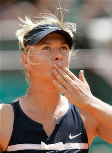 Russia's Maria Sharapova sends a kiss to spectators after winning against Russia's Evgeniya Rodina during their first round match at the French Open tennis tournament in Paris on Wednesday May 28, 2008. Sharapova won the match 6-1, 3-6, 8-6.
