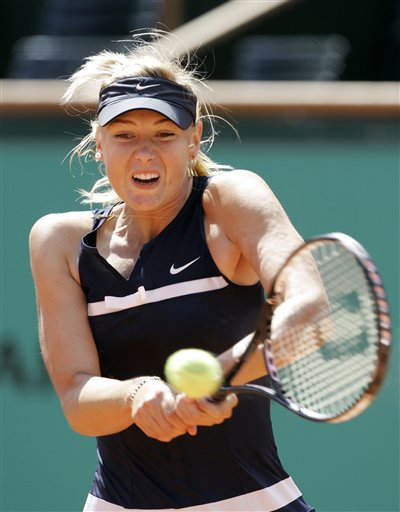 Russia's Maria Sharapova returns the ball to compatriot Evgeniya Rodina during their first round match of the French Open tennis tournament on Wednesday May 28, 2008 at the Roland Garros stadium in Paris.