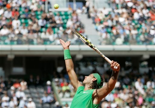 Defending champion Spain's Rafael Nadal serves to Brazil's Thomaz Bellucci during their first round match of the French Open tennis tournament, Wednesday May 28, 2008 at the Roland Garros stadium in Paris.