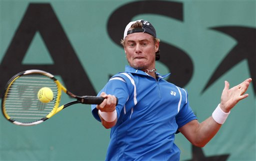Australia's Lleyton Hewitt returns the ball to France's Nicolas Mahut during their first round match of the French Open tennis tournament on Wednesday, May 28, 2008 at the Roland Garros stadium in Paris.