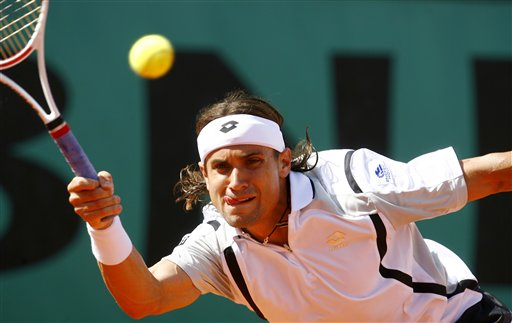Spain's David Ferrer returns the ball to Belgium's Steve Darcis during their first round match at the French Open tennis tournament in Paris on Wednesday May 28, 2008.