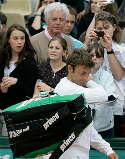 Spectators look on as Spain's Juan Carlos Ferrero leaves the court after his first round match against Brazil's Marcos Daniel at the French Open tennis tournament in Paris on Wednesday May 28, 2008.