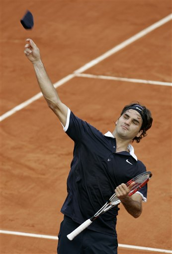 Top seeded Switzerland's Roger Federer throws his armband after defeating Spain's Albert Montanes during their second round the French Open tennis tournament on Thursday May 29, 2008 at the Roland Garros stadium in Paris.