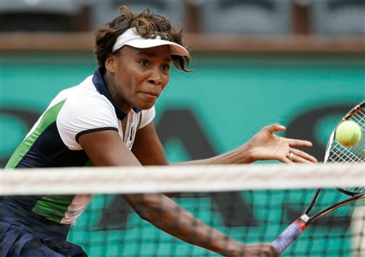 United States' Venus Williams volleys the ball to Tunisia's Selima Sfar during their second round match of the French Open tennis tournament on Thursday May 29, 2008 at the Roland Garros stadium in Paris.