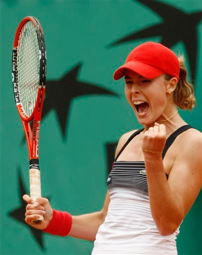 France's Alize Cornet jubilates after winning against Argentina's Gisela Dulko during their second round match at the French Open tennis tournament in Paris on Thursday May 29, 2008.