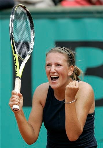 Belarus' Victoria Azarenka reacts as she defeats Italy's Francesca Schiavone during their third round match of the French Open tennis tournament on Saturday May 31, 2008 at the Roland Garros stadium in Paris.