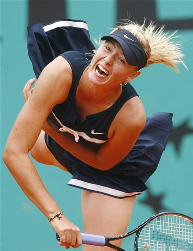 Russia's Maria Sharapova serves the ball to Italy's Karin Knapp during their third round match of the French Open tennis tournament on Saturday May 31, 2008 at the Roland Garros stadium in Paris.