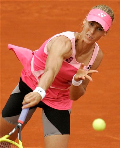Russia's Elena Dementieva returns the ball to Belarus' Olga Govortsova during their third round match of the French Open tennis tournament on Saturday May 31, 2008 at the Roland Garros stadium in Paris.