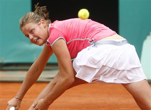 Italy's Karin Knapp returns the ball to Russia's Maria Sharapova during their third round match of the French Open tennis tournament on Saturday May 31, 2008 at the Roland Garros stadium in Paris.