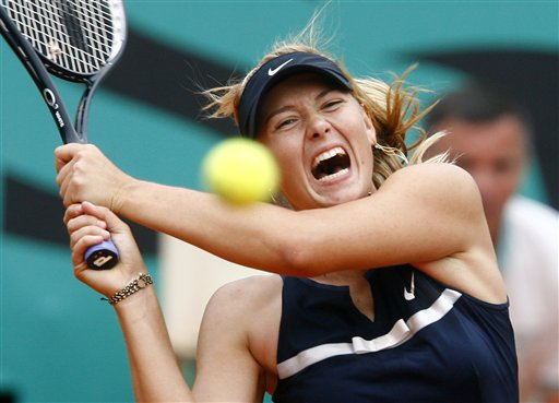 Russia's Maria Sharapova returns the ball to Italy's Karin Knapp during their third round match of the French Open tennis tournament on Saturday May 31, 2008 at the Roland Garros stadium in Paris.