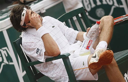 Jeremy Chardy reacts during a break as he plays Spain's Nicolas Almagro during their fourth round match at the French Open in Paris on June 1, 2008. (AP Photo)