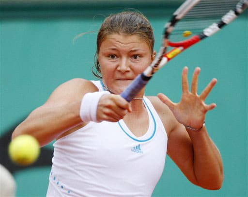Russia's Dinara Safina returns the ball to compatriot Maria Sharapova during their fourth round match of the French Open on June 2 at the Roland Garros stadium in Paris.