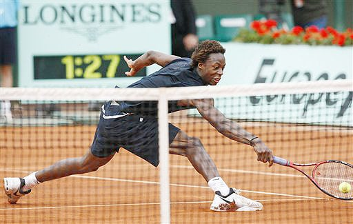 France's Gael Monfils goes up to the net to return the ball to Croatia's Ivan Ljubicic during their fourth round match at the French Open in Paris on Monday June 2, 2008.