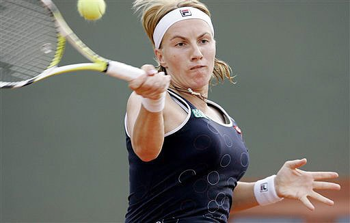 Russia's Svetlana Kuznetsova returns the ball to Bulgaria's Victoria Azarenka during their fourth round match at the French Open in Paris on Monday June 2, 2008.