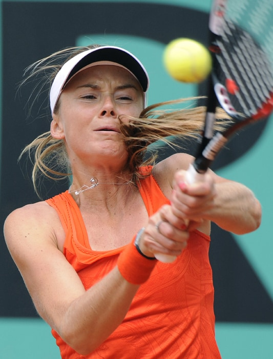 Slovakia's Daniela Hantuchova plays a return during her third round match against Belgium's Yanina Wickmayer. (AFP Photo)
