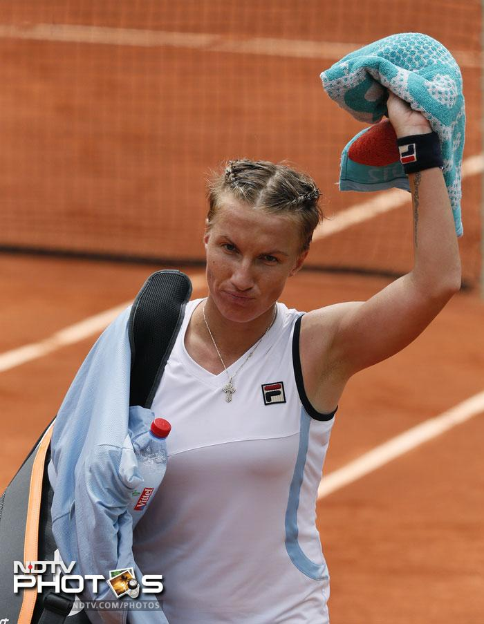 2009 champion Svetlana Kuznetsova was dismissed by Sara Errani, who made here second straight Grand Slam quarter final. The scoreline read a dismal 6-0, 7-5 for the Russian. (AFP Photo)