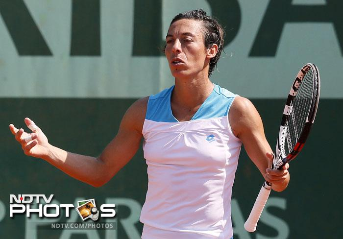 The 2010 French Open champion, Francesca Schiavone, was not only dumped out but also lost her ranking points to go out of the world top 20. (AFP Photo)