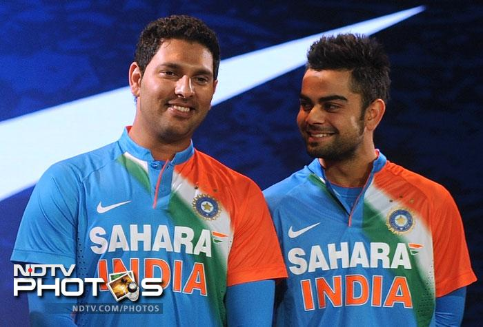 """The biggest applause of the day was reserved for Yuvraj Singh, who will make his comeback to the Indian team in the first T20I against New Zealand at Vishakhapatnam on September 8. """"I am feeling a bit nervous. I've been working really hard at the National Cricket Academy in Bangalore for the last couple of months,"""" said Yuvraj. Yuvraj Singh and Virat Kohli share a light moment at the launch of Team India's new jersey for the T20 format of cricket."""