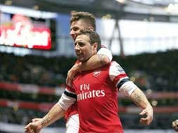 Arsenal remain on top, Manchester City surge forward while Chelsea sink Manchester United