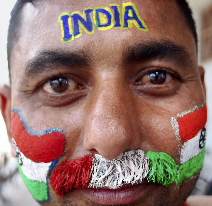 Innovation at his heights, A man paints his moustache with tri-colours.
