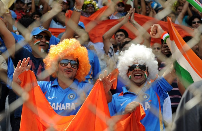 Fans turn on the fun factor in them by wearing tri-coloured wigs.